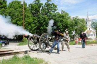 group of people shooting a cannon